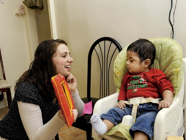 they recognize that professional and personal fulfillment supports maternal mental health. During the same visit, social worker Sarah McLanahan plays with Miguel.
