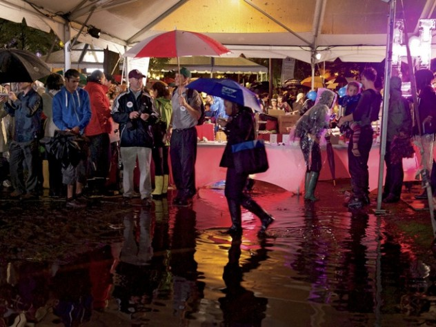 Harvard Yard had more standing water than solid ground, and partygoers gathered under the food tents to stay dry during downpours.