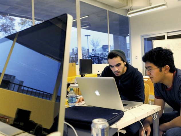 Gal Koren (left) and Tuan Ho at work in the lab