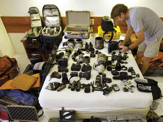 In Papua New Guinea, Tim Laman takes advantage of a rare hotel stop to dry out his 20 lenses, 4 camera bodies, audio and lighting gear, computers, and tree-climbing and camping equipment—not to mention his clothes and boots.