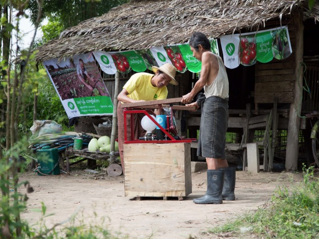A rural agency distributes Proximity Designs' equipment, such as the pump being demonstrated here.
