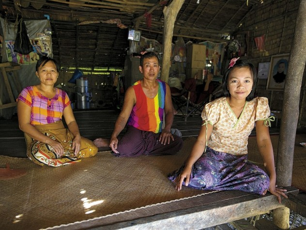Daw Than Than Sein, U Win Hlaing, and daughter Win Win Thu at their home in the Ayeyarwaddy River Delta village of Wakouktaw; Proximity Designs' irrigation equipment has helped them expand their farm and boost their income significantly.