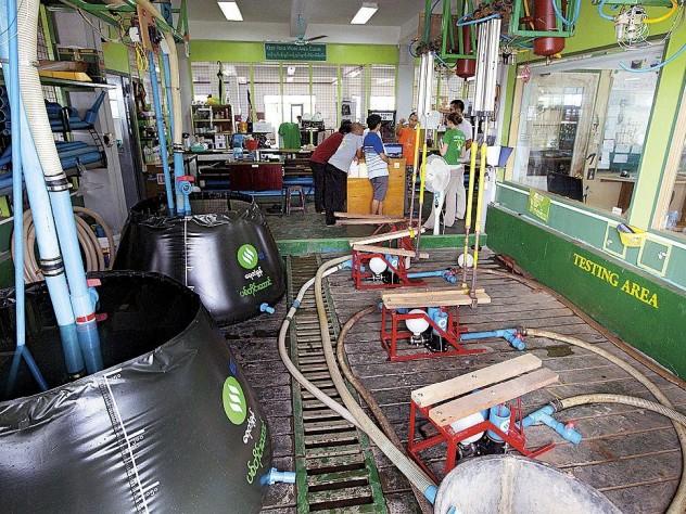 Testing Proximity Designs' pumps and water baskets at its Yangon factory.