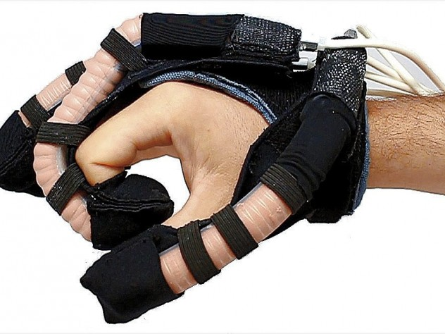 A soft robotic glove intended for hand rehabilitation therapy uses fluid-powered elastic tubes to mimic finger movements.