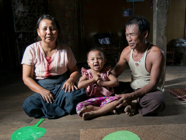 U Myat Thein, an entrepreneurial farmer and now a village agent for Proximity Designs, grows corn as a cash crop in Wakouktaw village, Kungyangon township; with his wife, Daw Khin Ohn Myint, and their youngest child, daughter Thin Thin Myat, he welcomes visitors to their home—fans at the ready for the delta's heat and humidity.