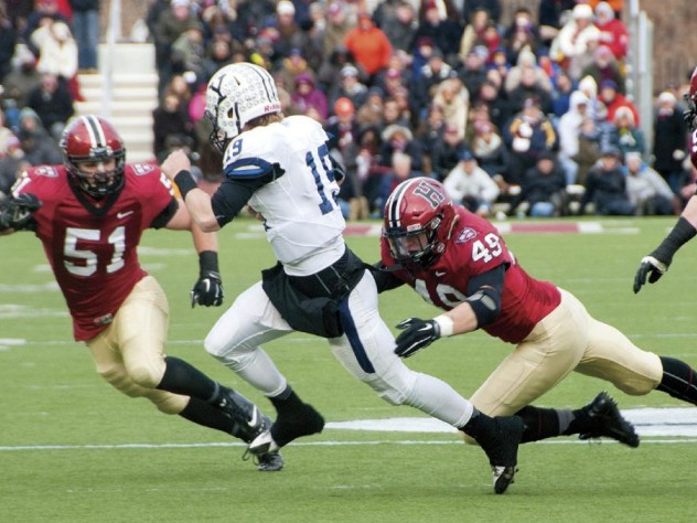 As so often happened this season, an opposing quarterback—in this case, Yale's Morgan Roberts—had nowhere to run against marauding Crimson defenders such as linebackers Jake Lindsey '16 (number 51) and Eric Medes '16 (number 49), who were helped by defensive tackle Miles McCollum '17.