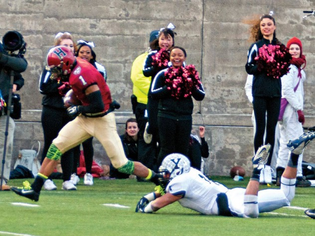 """The play that made """"slant and go"""" part of Crimson lore: having put a double move on Yale's Dale Harris, Andrew Fischer '16 capered into the end zone after catching the winning pass from Conner Hempel with 55 seconds left."""