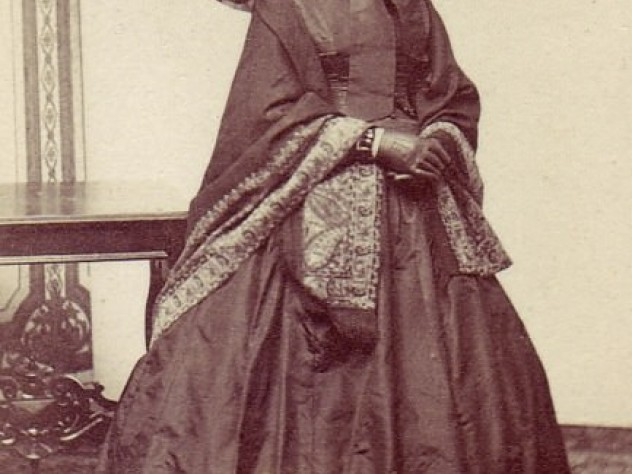 Catherine Hammond Gibson who, as a widow, bought the land and had the grand townhouse built in 1859-60