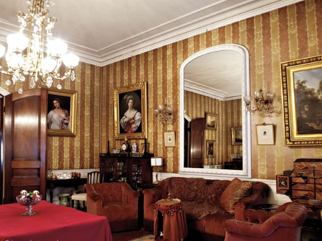 The music room, a family gathering spot, holds many treasures, including the Japanese apothecary chest and a lithophane lamp from Germany.