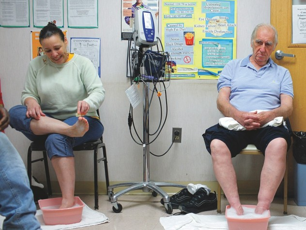 Patients at the BHCHP foot clinic, where other basic services, such as blood-pressure and diabetes checks, are available as well.
