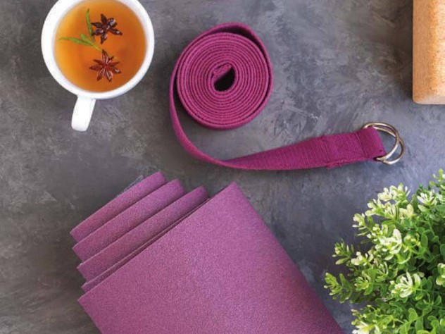 Yoga map, yoga strap, and cup of tea