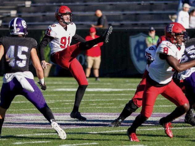 Photograph of outstanding junior punter Sean McKeogh in action against Holy Cross
