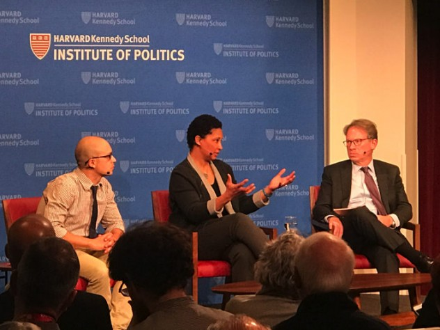 The three panelists on stage at the Kennedy School.