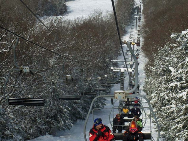 Chair lift carrying skiers to 45 trails