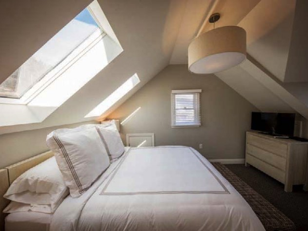 Sunlight flows into a Warfield House Inn bedroom