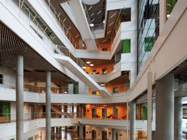 A photograph of the building's main eight-story atrium, which allows light to reach deep into the building.