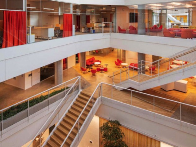 A second, smaller atrium includes a graduate-student lounge, a glassed-in level with red furniture.