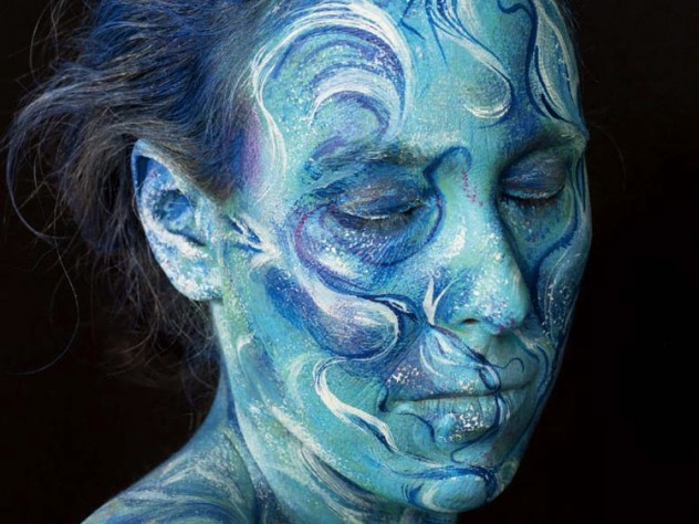 "Meyerhoff's self-portrait as ""ocean waves""—with blue hair, blue skin, and blue and white swirls indicating waves"