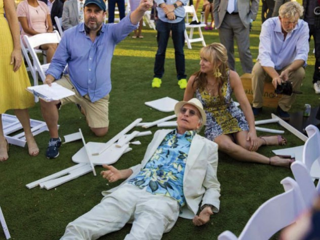 "Schaffer directs a ""Curb Your Enthusiasm"" scene in which David lies on the ground surrounded by other cast members."