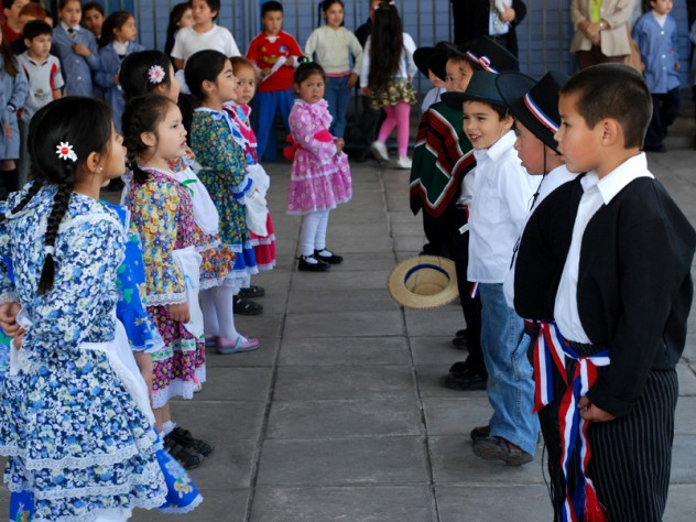 """Children perform """"cuecas,"""" a Chilean traditional dance, for visitors including Harvard professors who helped design UBC."""