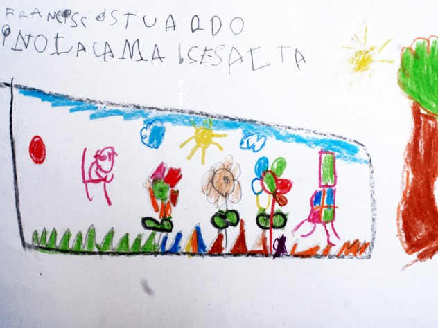 A close-up of a child's drawing depicting a scene from a book the child had read with a parent or teacher. These drawings, displayed outside a classroom at a UBC school, show the type of engagement with books the program tries to cultivate in students.