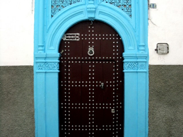 """A decorated residential door in the medina in Rabat, Morocco, 2005. The """"hand of Fatima"""" trident at upper left wards off evil and brings luck."""