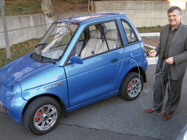 Jeffrey Leonard proudly drives a REVA electric car.