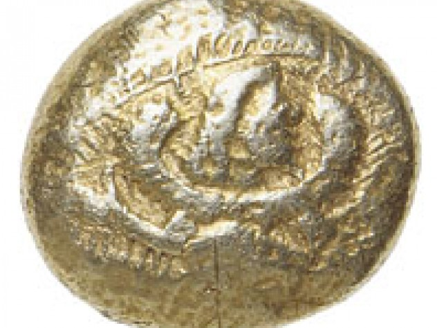 The earliest coin among Harvard's holdings, dating from 600-550 b.c., this rather battered specimen, made of electrum, shows on the obverse a bearded, winged figure. This makes it unique, the only extant coin of the period bearing a human image. Where it was made is not known, but it is similar in other respects to coins that were widely issued at the very beginnings of coinage, about 630 B.C., in western Asia Minor and cities on the Greek coast.