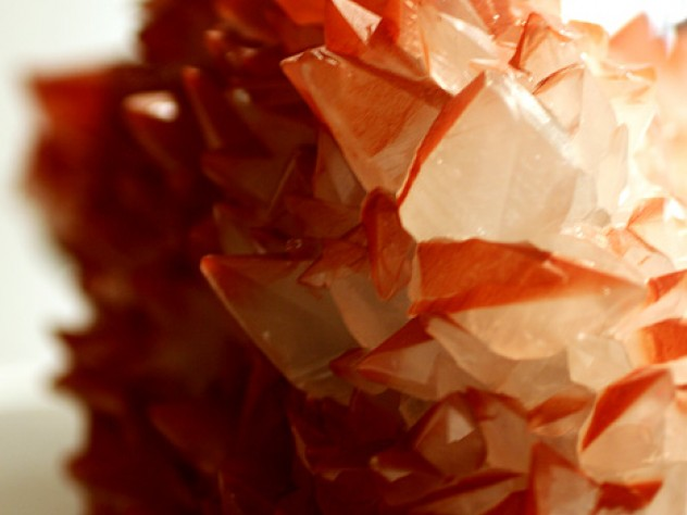 Calcite scalenohedrons (six-sided polyhedrons) with red hematite inclusions from the iron mines of West Cumbria, England