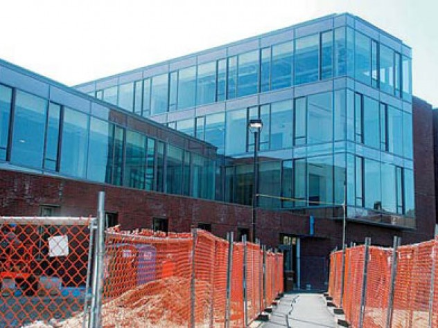 The brick-and-glass Northwest Science Building wends its way among existing structures along Hammond and Oxford streets.