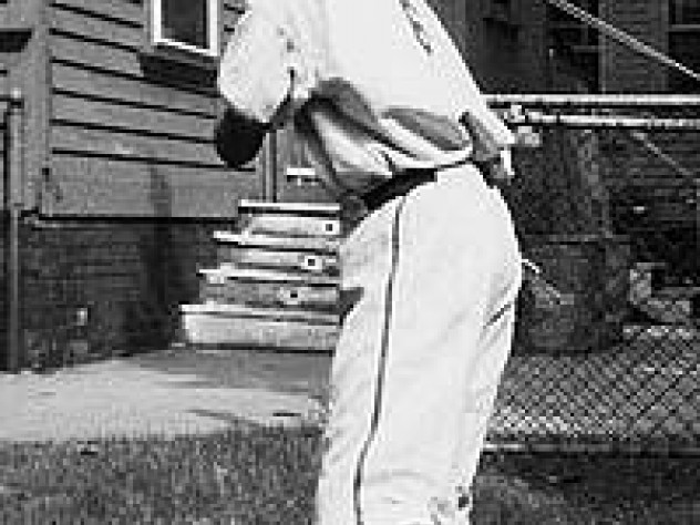Nicholas Dawidoff, in uniform here with bat at the ready at the age of 11, describes his devotion to the Red Sox in a new memoir.