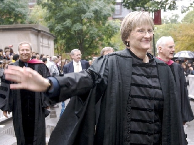 Drew Gilpin Faust, in the presidents division, enters Tercentenary Theatre for her installation. She is followed by former presidents Lawrence H. Summers, Neil L. Rudenstine (obscured), and Derek Bok; behind them is James Rothenberg, University Treasurer.