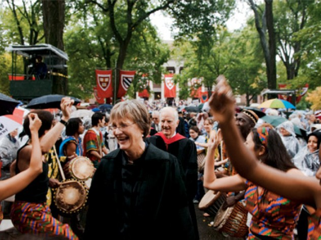 The Harvard College Pan-African Dance and Music Ensemble gives Drew Gilpin Faust, attired in Harvard's presidential gown, a raucous welcome. President emeritus Derek Bok and James R. Houghton, Senior Fellow of the Harvard Corporation, follow her in the procession into Tercentenary Theatre.