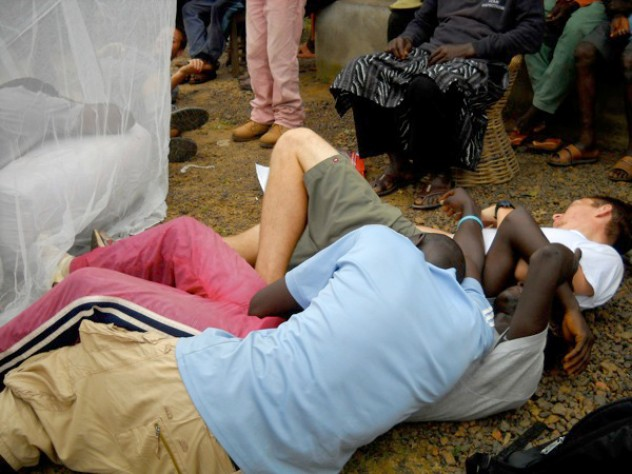 """The malaria skit's dramatic ending: after a brush with the insecticide-treated net, the """"mosquitoes"""" writhe around and die. The people who don't sleep under the net also keel over; the only survivor is Sengeh, who in the skit's last moments wakes up healthy."""