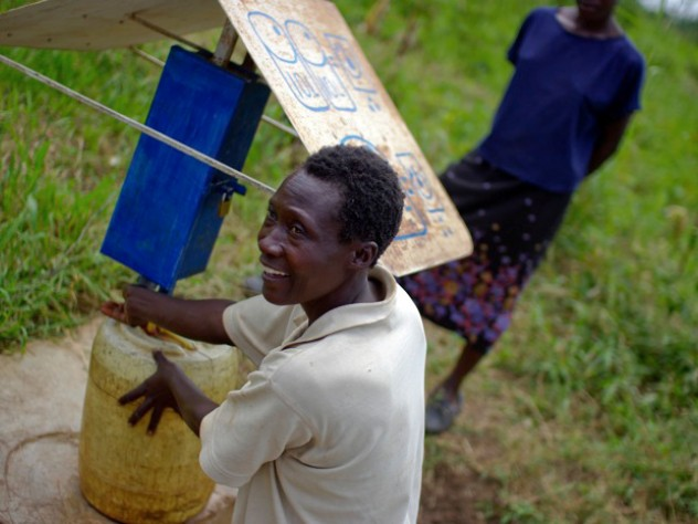At another collection site near Busia, Loice Pamba adds chlorine before filling her water jug.