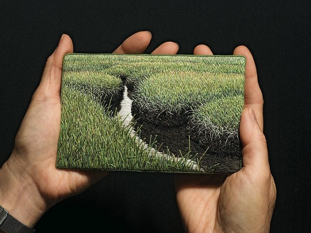 The artist holds <i>Summer Salt Marsh</i> (2008).
