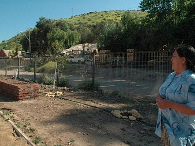 Ana Lamilla surveys the Renca development from the still-under-construction park on a ridge above. Behind her, part of the squatter settlement where she once lived remains.