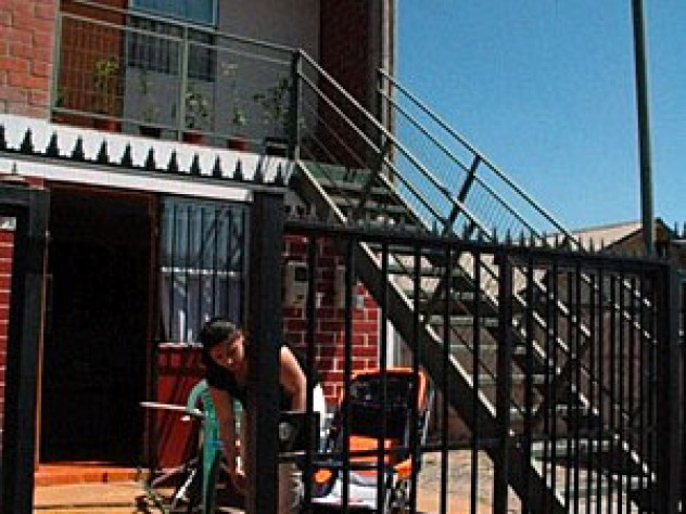 Joanna Vera's duplex; the woman pictured is her downstairs neighbor.