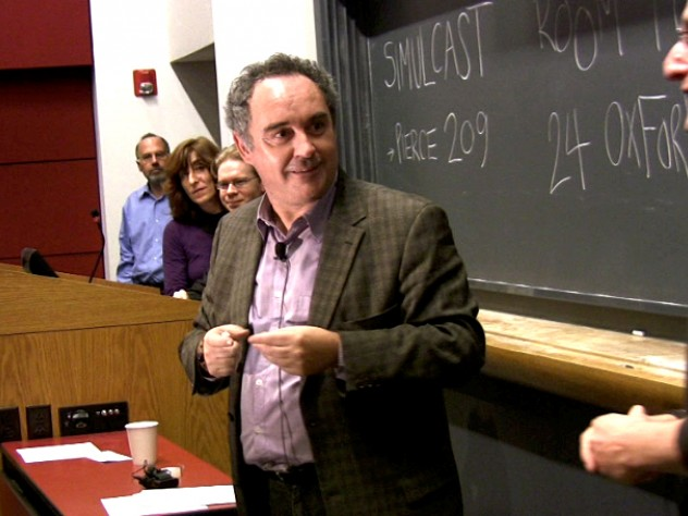 Ferran Adrià, dubbed the father of molecular gastronomy, pauses to let molecular geneticist Roberto Kolter (at right) translate during Adrià's public lecture at Harvard.