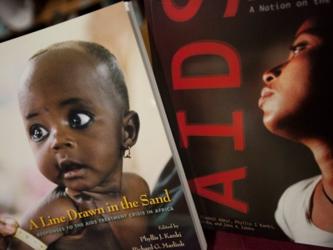 "An image from the cover of a book about AIDS treatment in Africa, edited by faculty members Phyllis Kanki and Richard Marlink, who spoke at the ""PEPFAR in Africa"" conference held at Harvard School of Public Health on January 10."