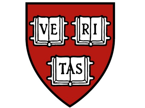 """Harvard shield with the Latin word """"veritas"""" meaning truth."""