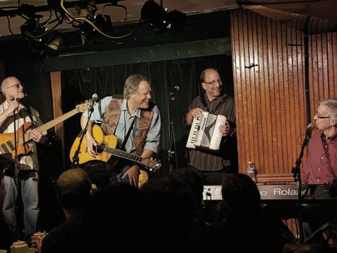 John Forster (at keyboard, right) with Tom Chapin (center) and his band, playing at the Turning Point in Piermont, New  York.