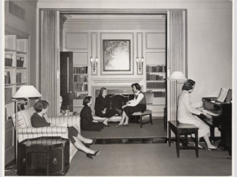 A group of Radcliffe students socialize in a common room in Moors Hall circa 1950.