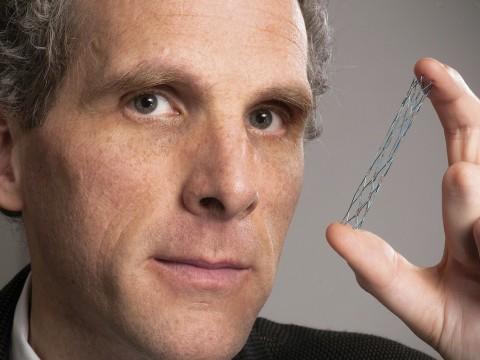David Jones holds a vascular stent (from the Warren Anatomical Museum), designed circa 1995 by radiologist Morris Simon of Harvard Medical School.