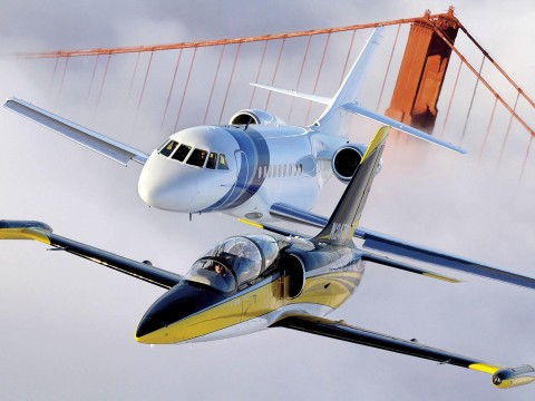 An Aero L-39 Albatros (foreground) and Dassault Falcon 2000 over the Golden Gate Bridge