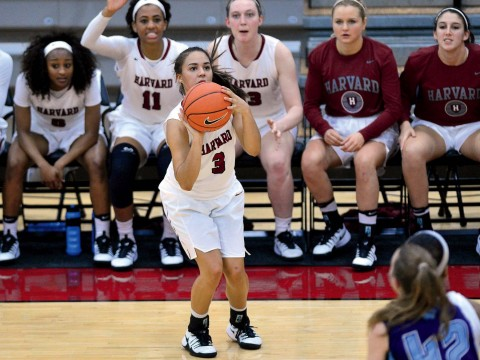 THE RIGHT STUFF: Freshman point guard Katie Benzan, shown shooting in the home opener against Maine, led the Harvard women's basketball team in minutes played and points scored per game through January, helping to spark 16 consecutive wins (after an initial loss at Minnesota)—tying the longest such streak in Crimson basketball history and raising hopes for an Ivy League championship.