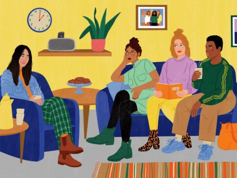 Four young women of different ethnic backgrounds converse in a homey lounge