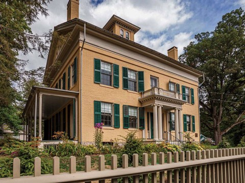 Photograph of Emily Dickinson's family home, The Homestead, an elegant wooden building