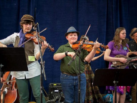 Three fiddlers playing