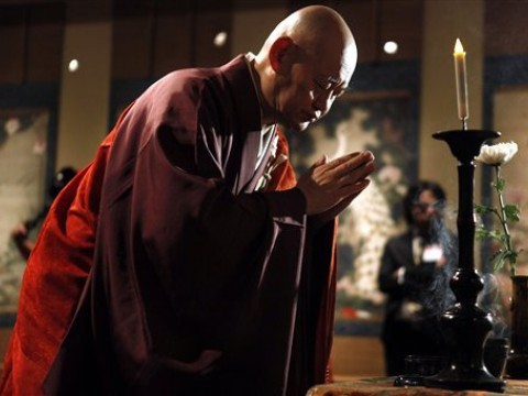 Reverend Raitei Arima, chief priest of Shokokuji Monastery in Kyoto, performs a blessing ceremony over a 30-scroll set of paintings from the 1700s, considered a cultural treasure of Japan, on March 26 at the National Gallery of Art in Washington, D.C. The museum is displaying the paintings, by Ito Jakuchu, to mark the centennial of Japan's gift of 3,000 cherry trees to the nation's capital.
